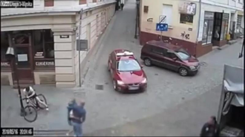 Biker narrowly misses car