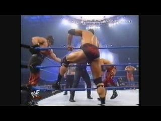 Undertaker & Kane and The Rock vs Kurt Angle and Edge & Christian(WWF SmackDown )