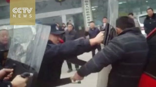 Watch: Chinese police subdue sword-wielding man