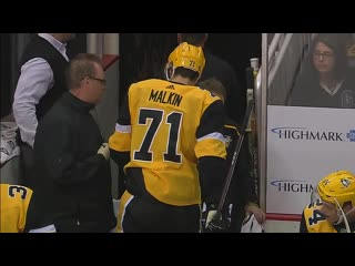 Penguins' evgeni malkin forced to dressing room after awkward hit into boards (1)