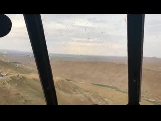 Вид из кабины российского вертолета Ми-8АМТШ на Пальмиру